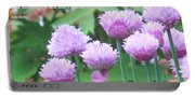 Purple Flowers In The Field Portable Battery Charger