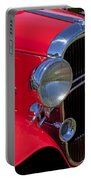 Red 1932 Oldsmobile Portable Battery Charger