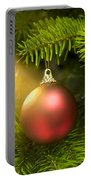 Red Ball In A Real Caucasian Fir Christmas Tree Portable Battery Charger