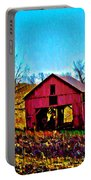 Red Barn On A Hillside Portable Battery Charger