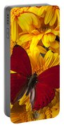 Red Butterfly On Yellow Gerbera Daisies  Portable Battery Charger