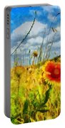 Red Flower In The Field Portable Battery Charger