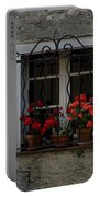 Red Geraniums In Window Portable Battery Charger