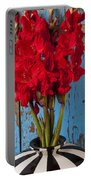 Red Glads Against Blue Wall Portable Battery Charger