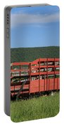 Red Hay Wagon In Green Mountain Field Portable Battery Charger