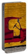 Red Truck Against Yellow Wall Portable Battery Charger