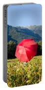 Red Umbrella On The Field Portable Battery Charger