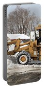 Removing Snow Portable Battery Charger by Ted Kinsman