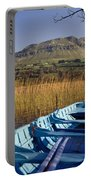 Row Boat Amongst Reeds On A Lake Portable Battery Charger