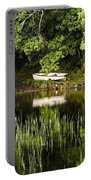 Rowboat Moored On The Bank Of A Lake Portable Battery Charger