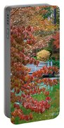 Rust Colored Leaves Over Autumn Pond Portable Battery Charger