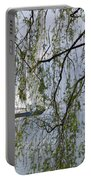 Sailing Boat Behind Tree Branches Portable Battery Charger