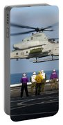 Sailors And Marines Watch An Ah-1z Portable Battery Charger