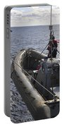 Sailors Lift A Rigid-hull Inflatable Portable Battery Charger
