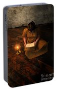 Schoolgirl Sitting On Wood Floor Reading By Candlelight Portable Battery Charger