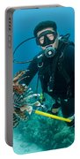 Scuba Diver With Spear Of Invasive Portable Battery Charger
