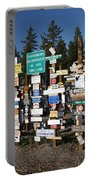 Sign Posts Forest In Watson Lake Yukon Portable Battery Charger