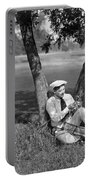 Silent Film Still: Golf Portable Battery Charger