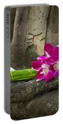 Sitting Buddha In Meditation Position With Fresh Orchid Flowers Portable Battery Charger