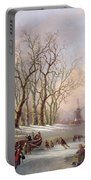 Skaters On A Frozen River Before Windmills Portable Battery Charger