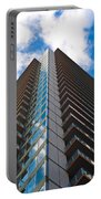 Skyscraper Front View With Blue Sky Portable Battery Charger