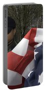 Soldier Unfurls A New Flag For Posting Portable Battery Charger by Stocktrek Images