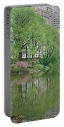 Spring Reflections Of Manhattan In Central Park Portable Battery Charger