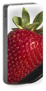 Strawberry On A Black Spoon Against White No.0003 Portable Battery Charger