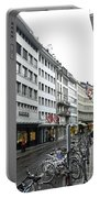 Street In Lucerne With Cycles And Rain Portable Battery Charger