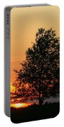 Square Photograph Of A Fiery Orange Sunset And Tree Silhouette Portable Battery Charger