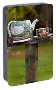 Teapot And Tea Cup On Old Post Portable Battery Charger