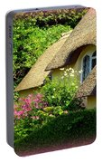 Thatched Cottage With Pink Flowers Portable Battery Charger