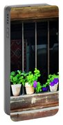 Time Worn Window With Bright Flowers Portable Battery Charger