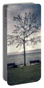 tree at lake Constance Portable Battery Charger by Joana Kruse