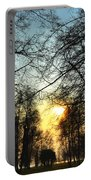 Trees And Sun In A Foggy Day Portable Battery Charger