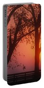 Trees In The Sunrise Portable Battery Charger