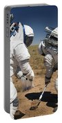 Two Astronauts Collect Soil Samples Portable Battery Charger by Stocktrek Images