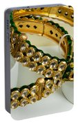 Two Green And Gold Bangles On Top Of Each Other Portable Battery Charger