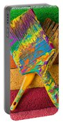 Two Paintbrushes On Paint Rollers Portable Battery Charger