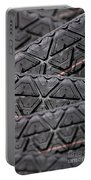 Tyres Stacked With Focus Depth Portable Battery Charger