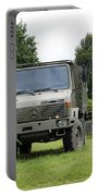 Unimog Truck Of The Belgian Army Portable Battery Charger by Luc De Jaeger