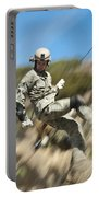 U.s. Air Force Airman Practices Portable Battery Charger