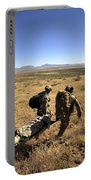 U.s. Air Force Pararescuemen Carry Portable Battery Charger