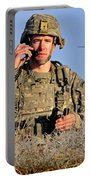 U.s. Army Captain Directs An Ah-64 Portable Battery Charger
