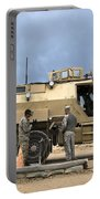 U.s. Army Sergeant Refuels A Caiman Portable Battery Charger