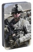 U.s. Army Soldier Conducts A Combat Portable Battery Charger