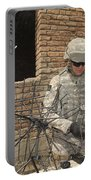 U.s. Army Soldier Configures Portable Battery Charger