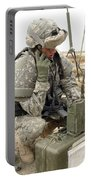 U.s. Army Soldier Performs A Radio Portable Battery Charger by Stocktrek Images