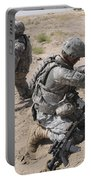 U.s. Army Soldier Sets Up A Satellite Portable Battery Charger