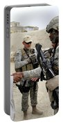 U.s. Army Soldier Shakes Hands With An Portable Battery Charger
